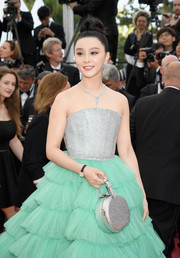 Fan Bingbing paired a silver Louis Vuitton purse with a two-tone strapless gown for the Cannes Film Festival opening gala.