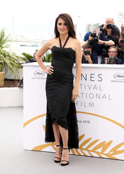Penelope Cruz complemented her LBD with black slim-strap sandals.