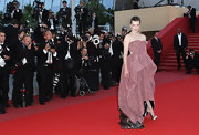 Milla looked gorgeous in a billowing embroidered gown with satin, peep toe slingbacks.