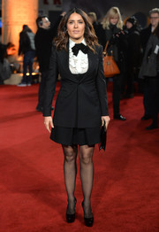 Salma Hayek chose an androgynous Saint Laurent skirt suit to the London premiere of 'Exodus: Gods and Kings.'