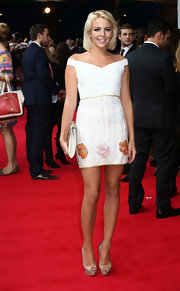 Lydia Bright walked down the red carpet at the premiere of 'What to Expect When You're Expecting' in a short off-the-shoulder dress.