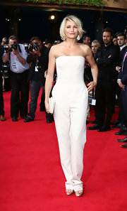 Cameron Diaz stepped onto the red carpet for the London premiere of 'What to Expect When You're Expecting' wearing a bright white strapless jumpsuit.