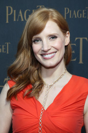 Jessica Chastain wore her hair with bouncy waves swept to the side during the Extremely Piaget launch.