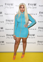 Jordyn Woods was stylish and sexy in a blue and orange turtleneck mini dress at the Eylure x Jordyn Woods launch party.