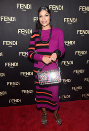 Rosario Dawson completed her colorful ensemble with a beaded purse by Fendi.