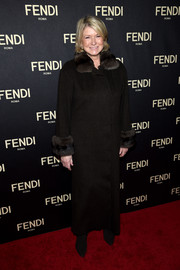 Martha Stewart attended the Fendi New York flagship store opening all covered up in a dark brown coat with a fur collar and cuffs.