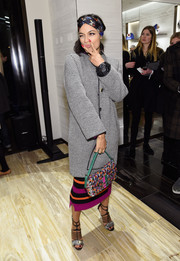 Rosario Dawson arrived for the Fendi New York flagship store opening wearing a classy monochrome tweed coat.