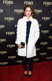 Sofia Coppola glammed up her casual shirt and slacks combo with an elegant white fur coat for the Fendi New York flagship store opening.
