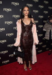 Rihanna polished off her look with a Fendi 3Baguette and Micro Baguette, which she designed for the label.