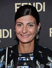 Giovanna Battaglia styled her hair into a sleek side-parted pony for the Fendi New York flagship store opening.