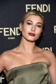 Hailey Baldwin opted for a simple center-parted bun when she attended the Fendi New York flagship store opening.