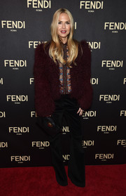 Rachel Zoe rocked a fluffy burgundy fur jacket with black bell-bottoms at the Fendi New York flagship store opening.