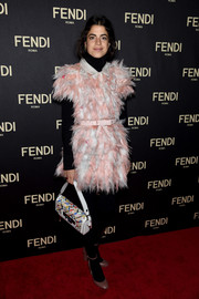 Leandra Medine matched her frilly outfit with a colorful Fendi 3Baguette.