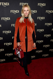 Shea Marie attended the Fendi New York flagship store opening looking chic in a red cape.