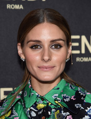 Olivia Palermo wore her signature center-parted style pulled back into a pony during the Fendi New York flagship store opening.