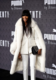Naomi Campbell attended the Fenty x Puma fashion show looking grand in a white fur coat.