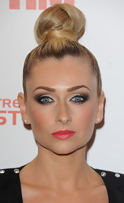 Gemma Merna pulled back her blonde locks into a cool blonde top knot for her red carpet look.