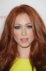 To keep her beauty look on the softer side, Natasha Hamilton chose a bubble gum pink lipstick.