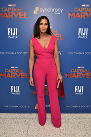 Padma Lakshmi showed off her svelte figure in a plunging pink jumpsuit by Gustavo Cadile at the special screening of 'Captain Marvel.'