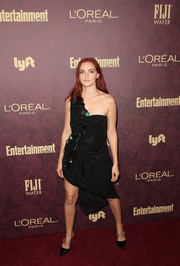 Black pumps with studded PVC straps sealed off Madeline Brewer's look.