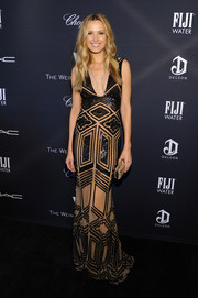 Petra Nemcova was Gatsby-glam at the Weinstein Company Oscar nominees dinner in a sultry low-cut gown featuring patterned black beading against a nude background.