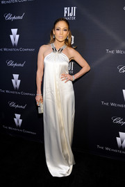 For the Weinstein Company Oscar nominees dinner, Jennifer Lopez donned a white silk halter gown that was more conservative than her usual style but still had that signature J. Lo allure.