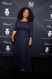 Oprah Winfrey opted for a simple navy evening dress when she attended the Weinstein Company Oscar nominees dinner.