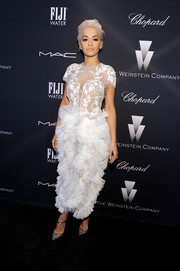 Rita Ora went all out with the frills in a white Marchesa dress with a sheer lace bodice and a ruffle skirt during the Weinstein Company Oscar nominees dinner.