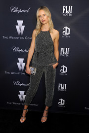 Karolina Kurkova kept it relaxed yet stylish in a black-and-white halter-neck jumpsuit during the Weinstein Company Oscar nominees dinner.