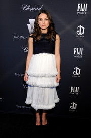 Keira Knightley dolled up her baby bump in a black-and-white Chanel Couture dress, featuring a flirty layered skirt, for the Weinstein Company Oscar nominees dinner.