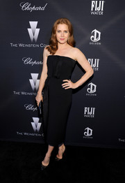 Amy Adams was classic and sophisticated in a black strapless dress during the Weinstein Company Oscar nominees dinner.