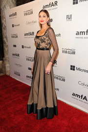 Gabriela Isler vamped it up in a mesh and lace gown with a nude underlay during the amfAR Inspiration Gala.
