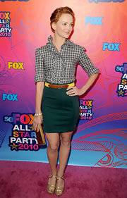 Jayma sported metallic espadrilles with a teal pencil skirt and a ruffled blouse.