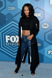 Serahay McNeill sported a black duster coat, crop-top, and jeans combo at the Fox 2016 Upfront.