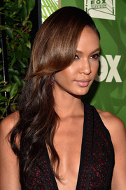 Joan Smalls styled her long hair with gentle waves for the Emmy Awards nominee celebration.