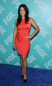Angelique Cabral's fitted red dress featured a stylish half-ruffle detailing that added a fun and flirty touch.