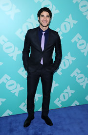 Darren Criss proved that yet again that he's one of Hollywood's best dress when he wore this sleek two-button suit over a deep purple button down and tie.