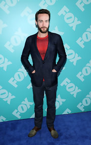 Tom Mison's navy chinos kept his look casual and relaxed.