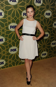 Maddie Hasson donned a white cocktail dress with a black leather waistband for the Fox All-Star Party.
