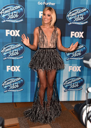 Carrie Underwood's legs were easily the stars of the show when she wore this Yanina Couture sheer gown to the 'American Idol' finale.