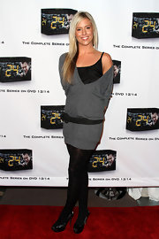 Natalie shows some shoulder in this charcoal v-neck sweater dress.