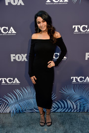 Emmanuelle Chriqui sheathed her slim figure in a body-con off-the-shoulder LBD for the Fox Summer TCA 2018 All-Star Party.