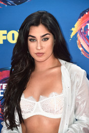 Lauren Jauregui topped off her look with long wavy tresses.