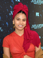 Zazie Beetz looked exotic wearing this red turban at the 'Atlanta Robbin' Season' FYC event.