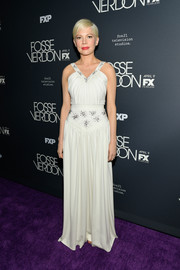 Michelle Williams looked charming in a white Louis Vuitton gown with a beaded neckline and waist at the New York premiere of 'Fosse/Verdon.'