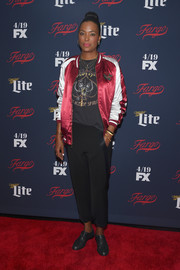 Aisha Tyler kept it casual all the way down to her flat oxfords.