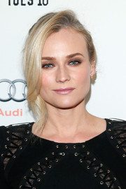 Diane Kruger swiped on lots of neutral eyeshadow for a sultry beauty look.