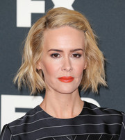 Sarah Paulson swiped on some bright orange lipstick for a vibrant beauty look.