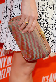 Fiona Gubelmann attended the FXX Network launch carrying a chic metallic gold hard-case clutch.