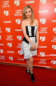 A pair of black cutout boots added a bit of an edge to Fiona Gubelmann's girly look during the FXX Network launch.